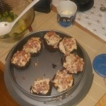 Bacon chocolate cupcakes with maple sirup and bacon topping