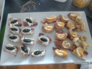 Bacon canapee, cream cheese and liquorice boat and cheese dip and bacon crisp